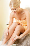 Female hands and legs in spa salon Stock Photos