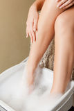 Female hands and legs in spa salon Stock Photo