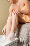 Female hands and legs in spa salon Royalty Free Stock Images