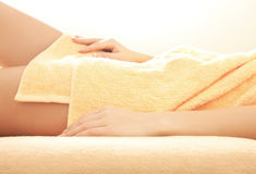 Female hands and legs in spa salon Royalty Free Stock Photo