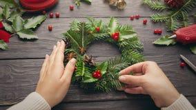 Female hands make Christmas wreath royalty free stock image