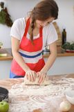 Female hands making dough for pizza or bread on wooden table. Baking concept Royalty Free Stock Image