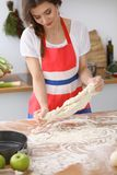Female hands making dough for pizza or bread on wooden table. Baking concept Royalty Free Stock Photography