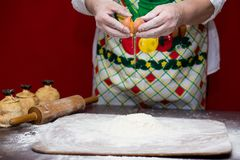 Female hands making dough for pizza Stock Photo