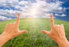 Female Hands Making a Frame Over Grass and Sky Royalty Free Stock Photo