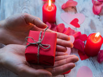 Female hands making gift box. Love and valentine concept. Stock Photography