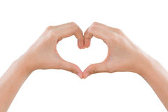 Female hands making a heart shape isolated on white Stock Images