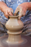 Female hands making pottery Stock Photos