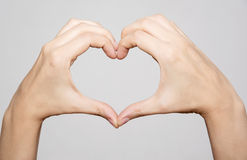 Female hands making shape heart. Symbol of lovers royalty free stock photo