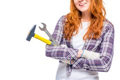 Female hands with male tools close-up on a white. Background stock image