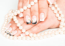 Female hands with manicure closeup on light Royalty Free Stock Photography