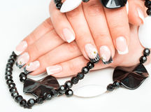 Female hands with manicure closeup on light Stock Photography