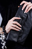 Female hands with manicure with a handbag Royalty Free Stock Photos