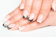 Female hands with manicure on a light background Royalty Free Stock Photo