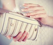 Female hands with manicure with white handbag Royalty Free Stock Image