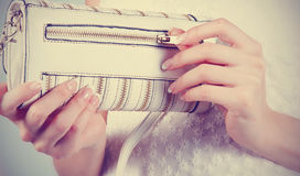 Female hands with manicure with white handbag Stock Image