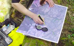 Female hands marking waypoints on the map Stock Photos
