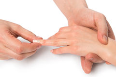 Female hands, massage therapist works with the fingers. Close up Stock Image