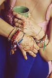 Female hands with mehndi Stock Photos