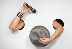 Female hands with microphone and hat Royalty Free Stock Image