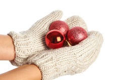 Female hands in mittens with Christmas balls isolated Stock Image