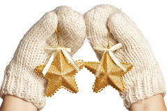 Female hands in mittens with Christmas stars isolated Royalty Free Stock Images