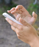 Female hands with the mobile phone Royalty Free Stock Image