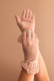 Female hands modeling vintage see through gloves Royalty Free Stock Image