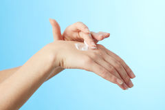 Female hands in moisturizer cream Royalty Free Stock Photography