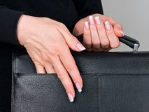 Female hands and nails. Well-groomed female hands and the varnished nails Stock Photography