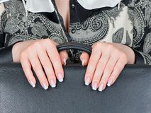 Female hands and nails. Well-groomed female hands and the varnished nails Stock Images