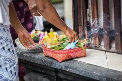 Female hands offering food to God Stock Images