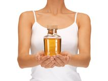 Female hands with oil bottle Stock Photo
