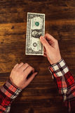 Female hands and one dollar tip Stock Image