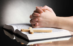 Female hands on open   holy bible Stock Photography
