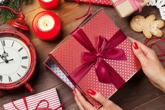 Female hands opening christmas gift Stock Photos