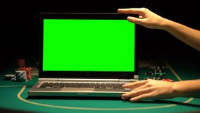 Female hands opening laptop, poker chips around, online casino advertising. Stock footage stock video footage