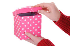 Female Hands Opening a Pink Gift Box Stock Image