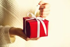 Female hands opening red gift box, copy space. Christmas, new year, birthday party, valentine`s day, mother`s and woman stock photo