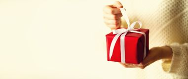 Female hands opening red gift box, copy space. Christmas, new year, birthday party, valentine`s day, mother`s and woman stock image