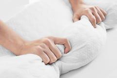 Female hands on orthopedic pillow. Closeup stock photos