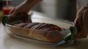 Freshly baked pie in glass baking tray on table stock video footage