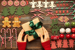 Female hands over christmas gift Royalty Free Stock Images