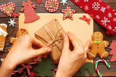 Female hands over christmas gift Royalty Free Stock Image