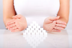 Female hands over a pyramid of sugar Royalty Free Stock Photo