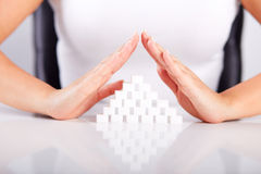 Female hands over a pyramid of sugar Royalty Free Stock Images