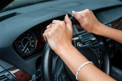 Female hands over a wheel in the car Royalty Free Stock Photo