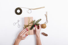 Female hands packed and decorated boxes with gifts Stock Photos