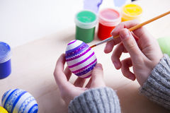 Free Female Hands Painting Wooden Easter Egg With Brush Stock Photography - 86442502