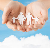 Female hands with paper man family Royalty Free Stock Photo